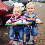 Shopping trolley and children in the seats